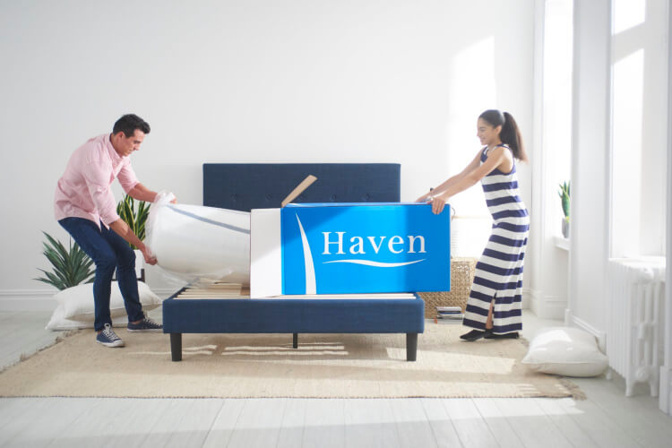 couple unboxing haven mattress