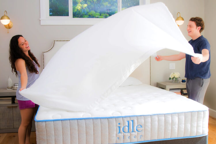 Couple dressing an Idle Sleep mattress