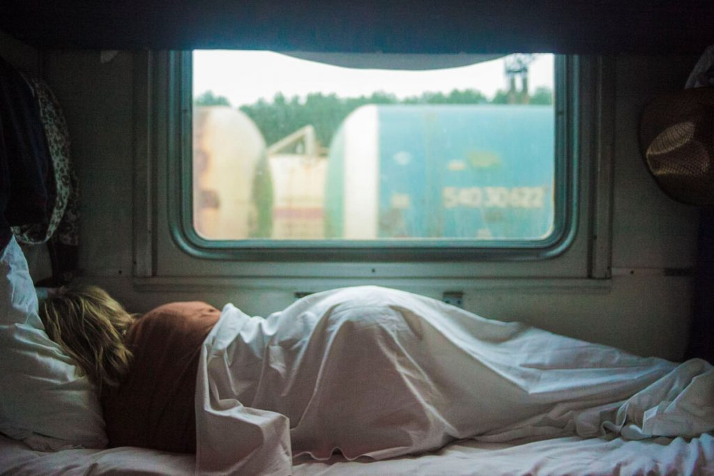 A person sleeping on an RV mattress